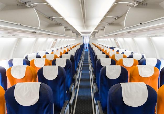 Empty passenger airplane seats in the cabin Premium Photo