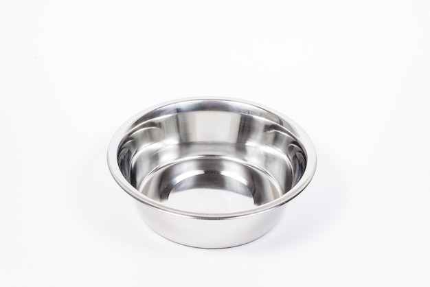 Empty pet cup isolated. metal food and water bowl for cat or dog Premium Photo