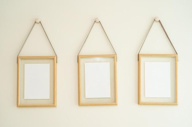 Empty photo frames on wall Free Photo