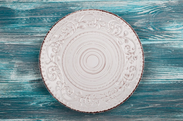 Empty plate over wooden table Premium Photo