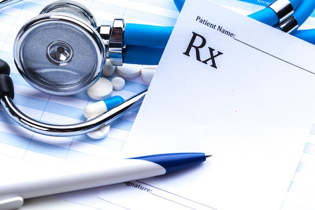 Empty prescription  lying on table with stethoscope Premium Photo
