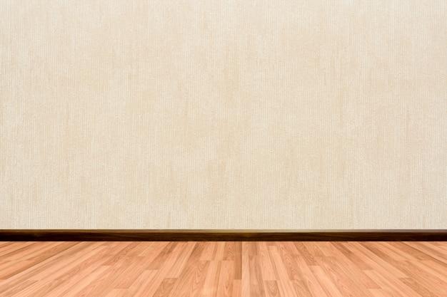 Empty room background with wooden floor cream or beige wallpaper. Premium Photo