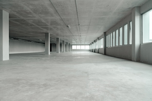 Empty room office space building with cement material structure Premium Photo