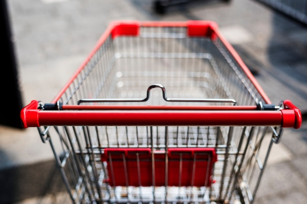 Empty shopping trolley left outside Free Photo