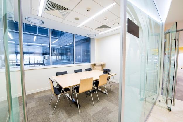 Empty small meeting room. bright modern interior. glass walls Premium Photo