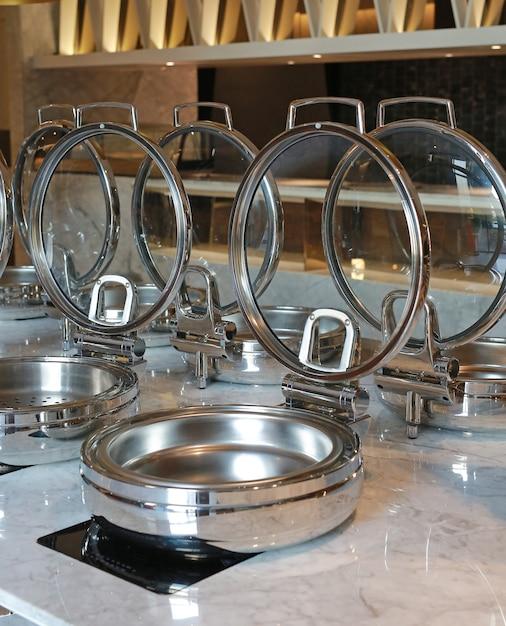 Empty steamer pot on electric stove, smorgasbord. Premium Photo
