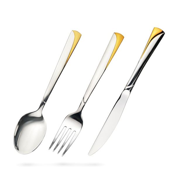 Empty steel table spoon, fork, knife iisolated on white Premium Photo