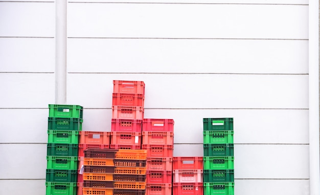 Empty stock basket stack up in back office of convenience store supply house Premium Photo