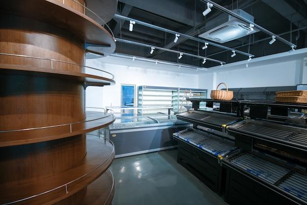 Empty store shelf in the super market Premium Photo