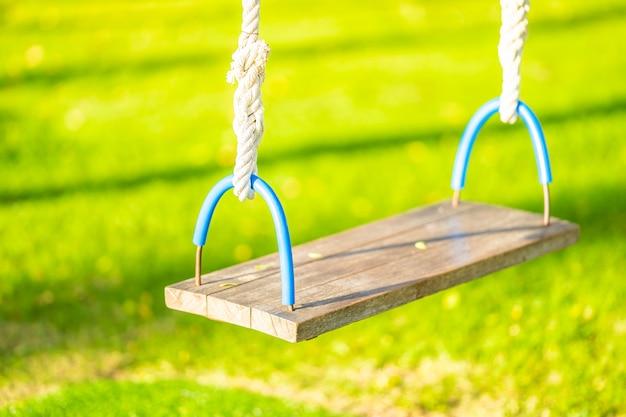 Empty swing in the garden park Free Photo