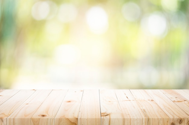 Empty table for present product with green bokeh. Premium Photo