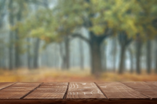 Empty table top on autumn background Premium Photo