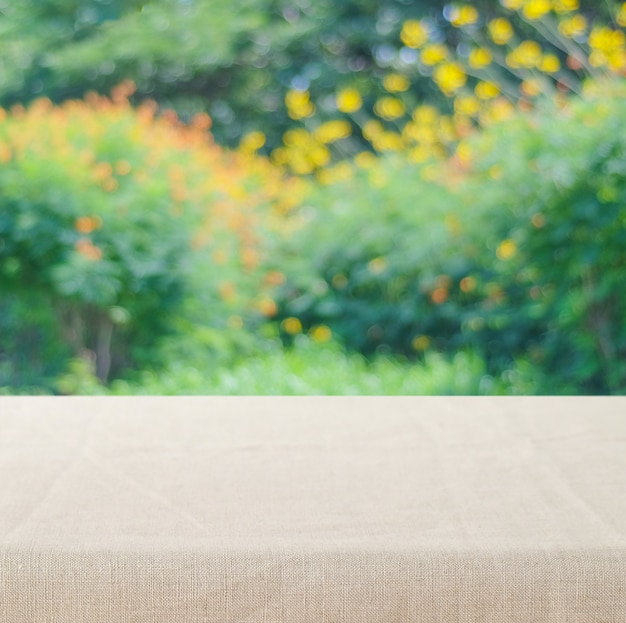 Empty table with linen tablecloth over vintage cement wall background Premium Photo