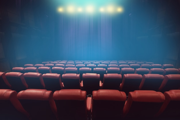 Empty theater auditorium or movie cinema with red seats before show time Premium Photo