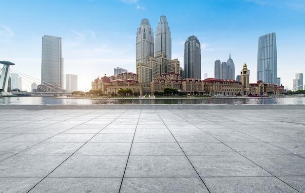Empty tiled floor and urban skyline,tianjin china. Premium Photo