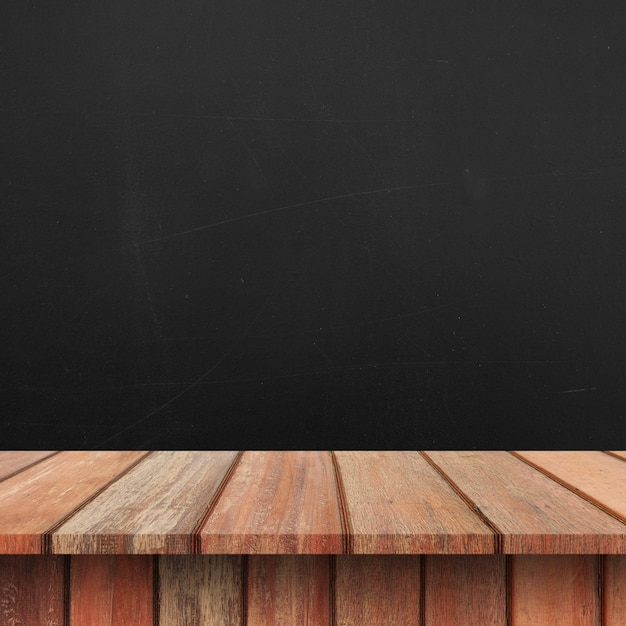 Empty top Wood shelves or table on wall background. Premium Photo