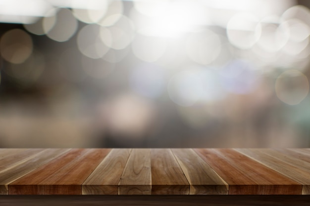 Empty top wooden table wood floor brown color texture with white broken view Premium Photo