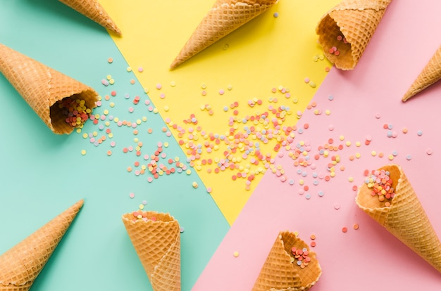 Empty waffle cones with sugar sprinkles Free Photo