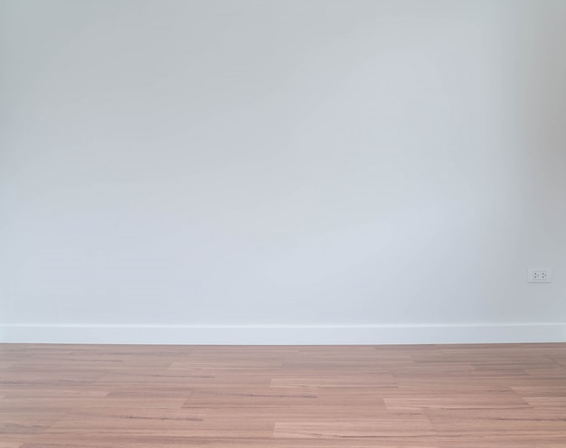 Empty wall with a wooden floor below Free Photo