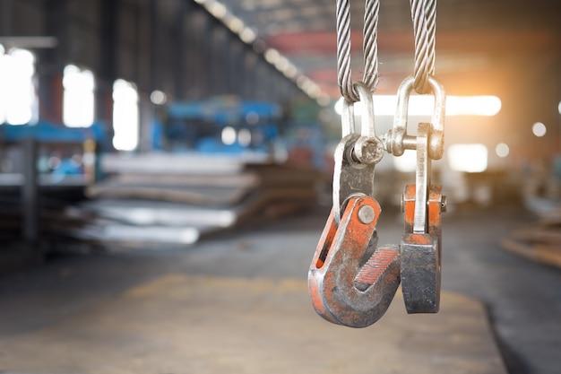 Empty warehouse interior with crane hook Premium Photo