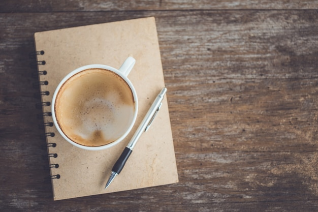 Empty of white ceramic coffee cup on wooden table Premium Photo