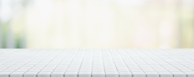 Empty white ceramic mosaic table top and blurred bokeh cafe and restaurant banner background Premium Photo