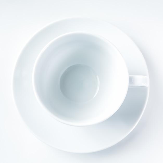 Empty white coffee cup on white background Premium Photo