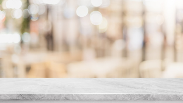 Empty white marble stone table top and blur glass window wall  background Premium Photo