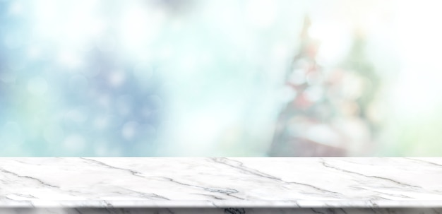 white marble table top. Empty White Marble Table Top With Abstract Muted Blur Christmas Tree And Snow Fall Background
