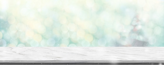 Empty white marble table with abstract blur green christmas tree and snow fall Premium Photo