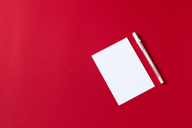 Empty white paper sheet isolated on red background Premium Photo