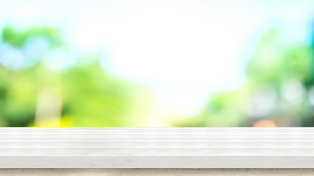 Empty white rustic wood table top with blur blue green tree bokeh Premium Photo