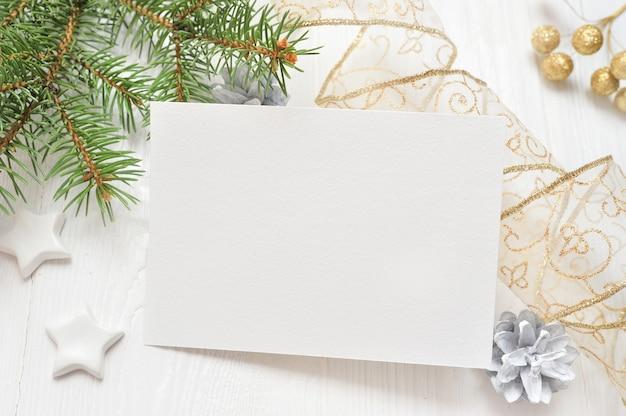 Empty white sheet of paper on a white christmas background Premium Photo