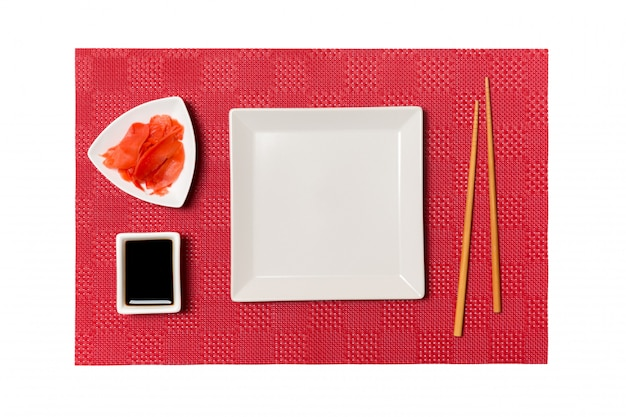 Empty white square plate with chopsticks for sushi Premium Photo