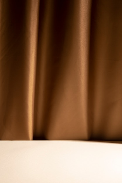 Empty white table in front of brown curtain Free Photo