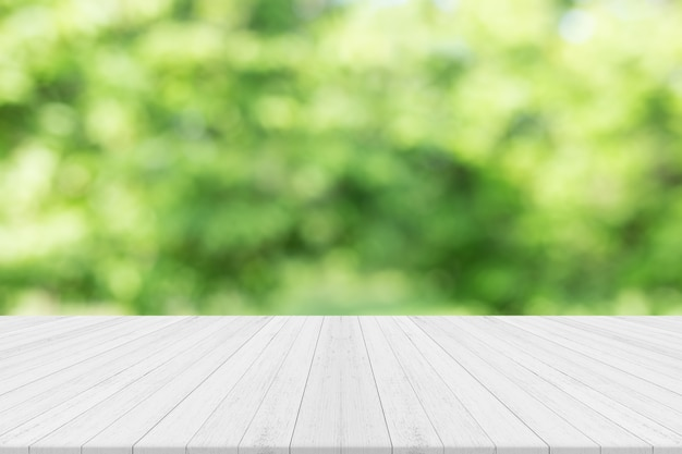 Premium Photo Empty White Wooden Table With Nature Green Blurred Background Free Space For Product Editing