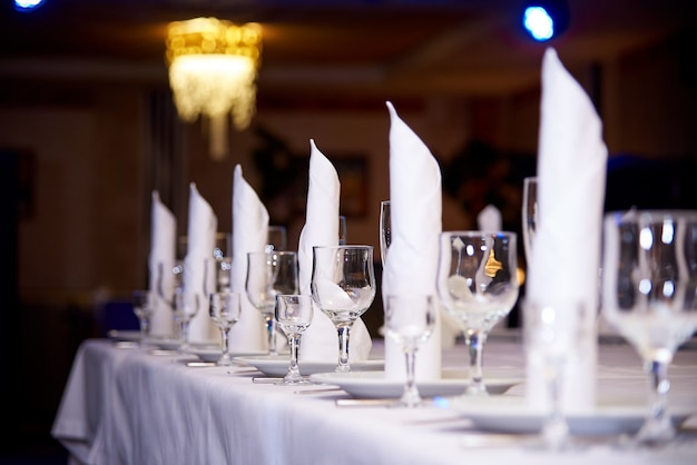 Empty wine glass on the banquet table.table setting for a banquet or dinner party. Premium Photo