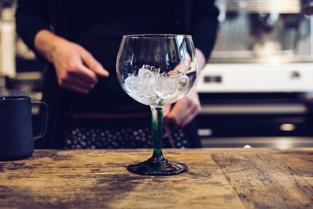 Empty wine glass with ice Free Photo