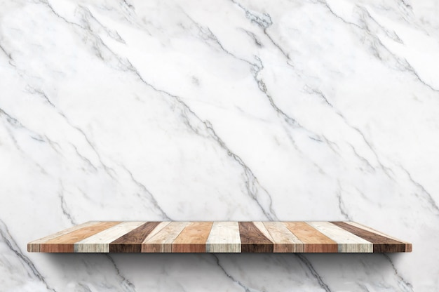 Empty wood plank shelf at white marble wall background Premium Photo