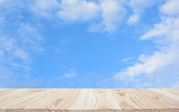 Empty wood table top and blue sky background with copyspace for display or montage your products Premium Photo