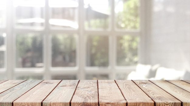 Empty wood table top and blurred bokeh cafe and restaurent interior background with vintage filter Premium Photo