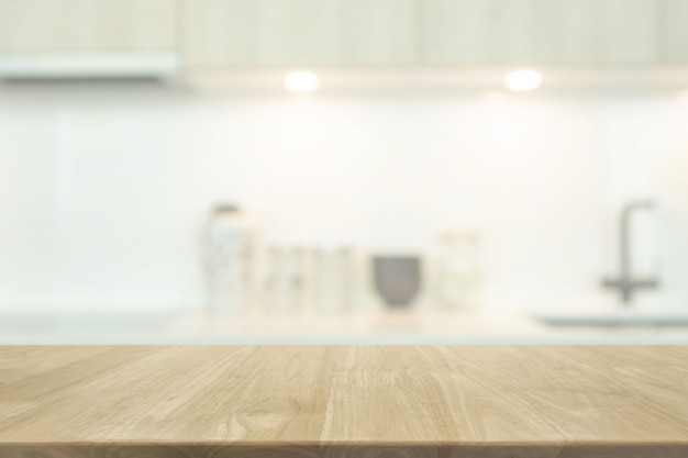 Empty wood table top and blurred kitchen interior background with vintage filter Premium Photo