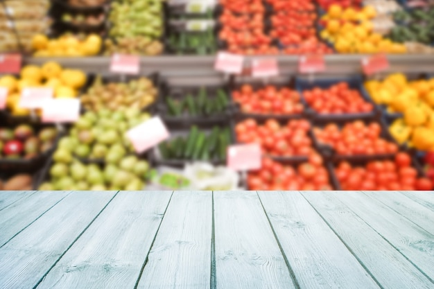 Empty wood table top on blurred market fruit,shop. Premium Photo