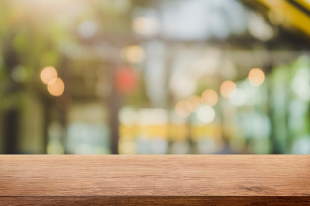 Empty wood table top and blurred restaurant interior background Premium Photo