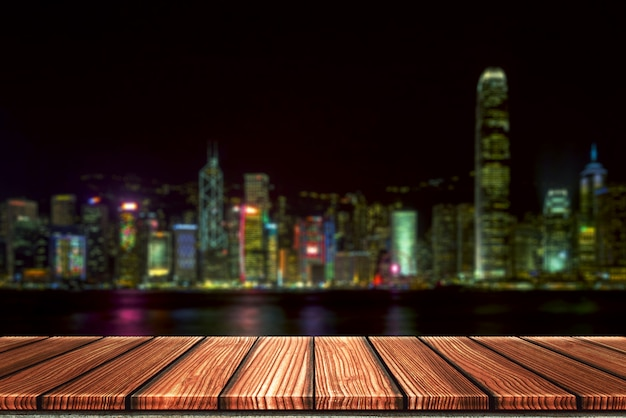 Empty wooden board top table in front of night city blurred background. Premium Photo