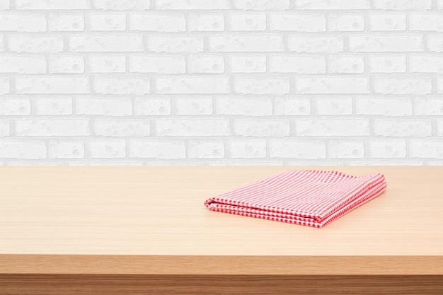 Empty Wooden Deck Table With Tablecloth Over White Brick Wallpaper Background. Perfect For Product M