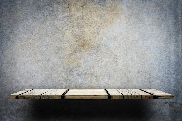 Empty wooden display counter on gray background Premium Photo