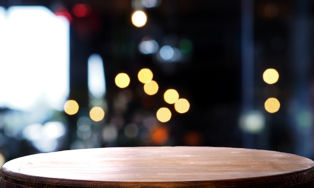 Empty wooden table blur light coffee shop Premium Photo