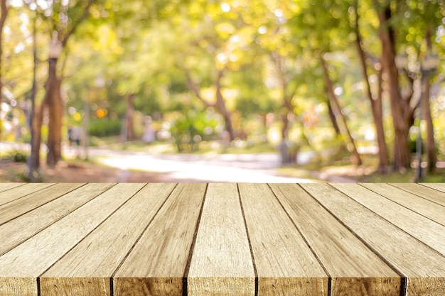 Empty wooden table over blur nature park outdoor ...