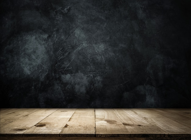 Empty wooden table over grunge wall empty ready for your product display or montage. Premium Photo